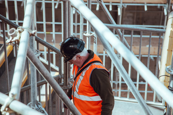 Man with hard hat on construction site