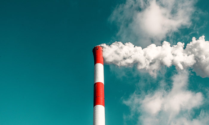 Image of a smoke stack signifying the industrial first aid kits